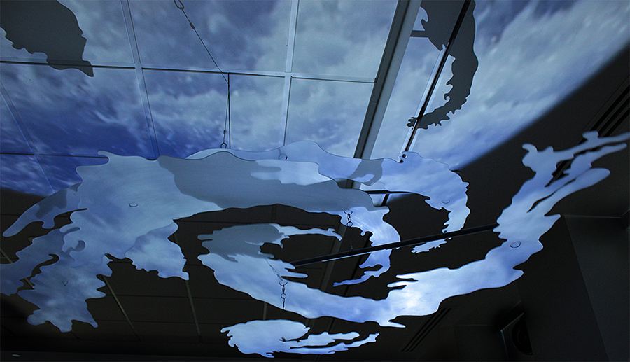 Hovering Hurricane (Sandy 2012) Single-channel video installationand kinetic sculpture Four polycarbonate sections, hanging hardware Full rotation diameter: 10 feet Video: 10:54 min (continuous loop, with audio) 2014